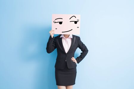 business woman take look somewhere billboard, isolated blue background Stock Photo