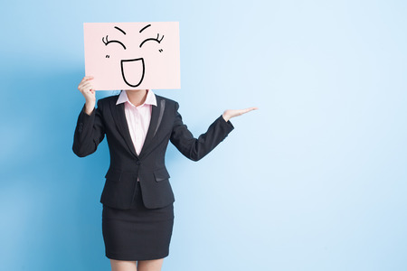 happy workers: business woman take happy billboard and show something, isolated blue background Stock Photo