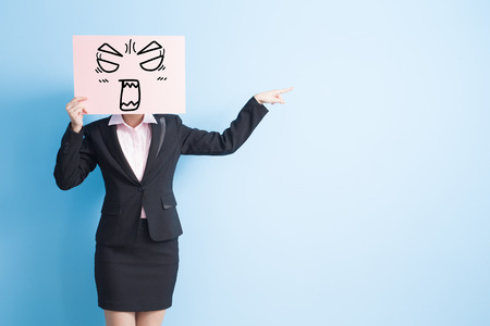 negative spaces: business woman take angry billboard and show something,isolated blue background