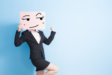 business woman take look somewhere billboard and make a fist, isolated blue background