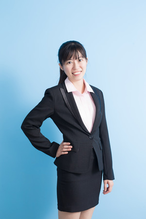 business asia: business woman smile to you isolated blue background, asia Stock Photo