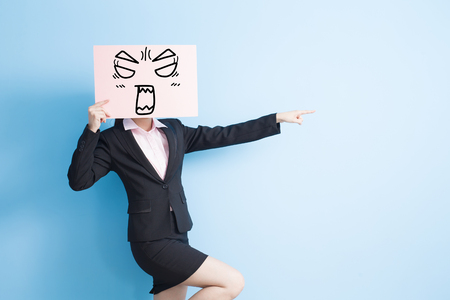 business woman take angry billboard and show something,isolated blue background