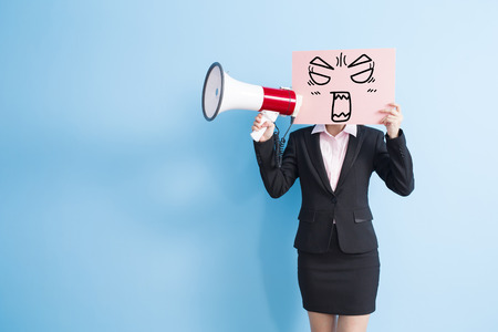 billboard background: business woman take angry billboard and microphone ,isolated blue background