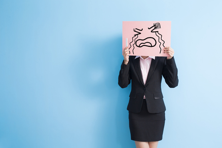 billboard background: business woman take cry billboard and speak phone, isolated blue background Stock Photo
