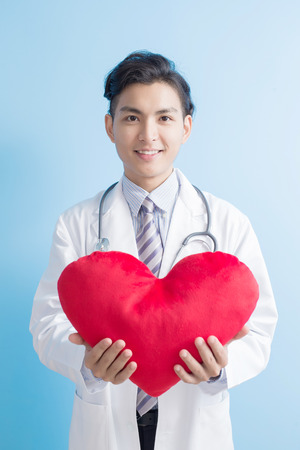 male doctor take love heart to you,asian