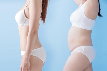 Fett übergewichtige Frau und schlanke Frau auf blauem Hintergrund, asiatisch