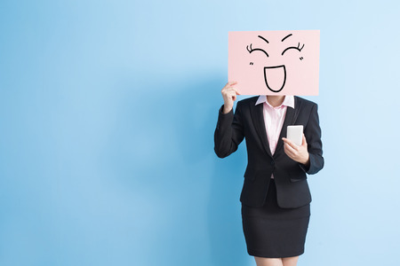 billboards: business woman take happy billboard and use smart phone, isolated blue background