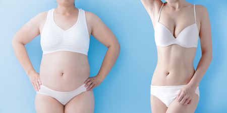 fat overweight woman and slim woman isolated on blue background, asian Stock Photo