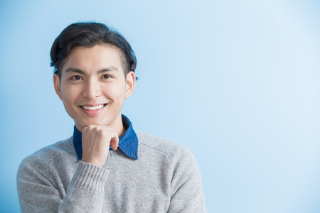 man smile to you with blue background, asian