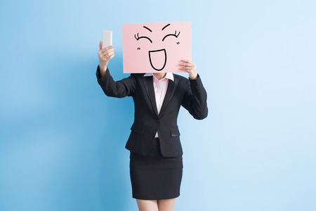 billboard background: business woman take happy billboard and selfie, isolated blue background Stock Photo