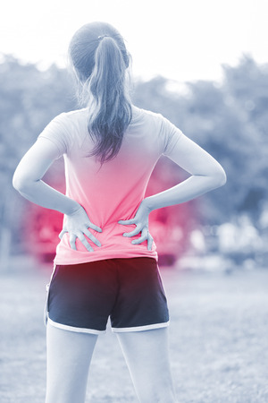 sport woman waist injury in the park,great for your design