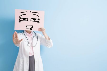 overwork: woman doctor take tired billboard and show stop ,asian