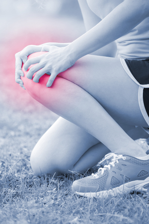 calf strain: sport woman Knee injury in park, great for your design