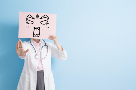 woman doctor take angry billboard and show stop ,asian