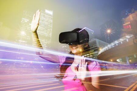 double game: Double exposure of happy woman using VR-headset glasses for virtual reality concept Stock Photo