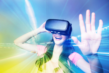 Double exposure of happy woman using VR-headset glasses for virtual reality concept Stock Photo