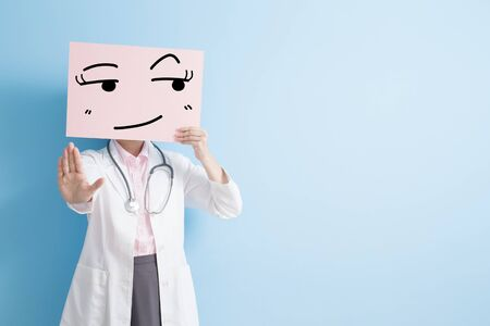 woman doctor take look somewhere billboard and show stop ,asian