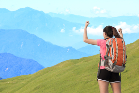 woman climbing moutain and feel excited ,asian
