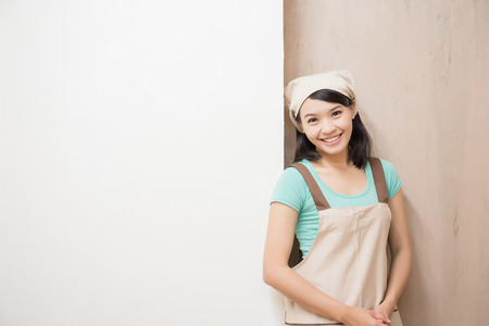 woman woodworking look and smile happily ,asian Stock Photo