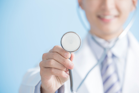 male doctor show stethoscope to you, asian Stock Photo