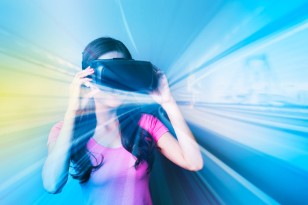 computer simulation: Double exposure of happy woman using VR-headset glasses for virtual reality concept Stock Photo