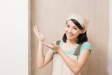 woman woodworking smile happily and show something ,asian Stock Photo