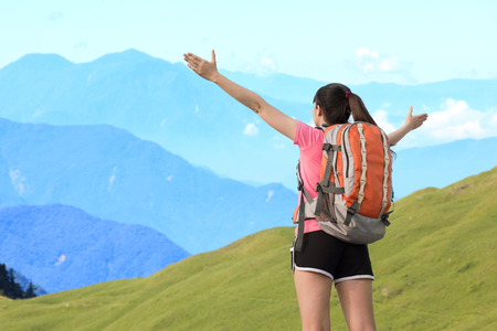 formosa: woman climbing moutain and feel free ,asian