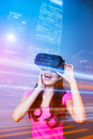 Double exposure of happy woman watching VR-headset glasses for virtual reality concept