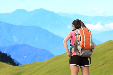 formosa: Woman carrying a sports backpack and look somewhere on the moutain