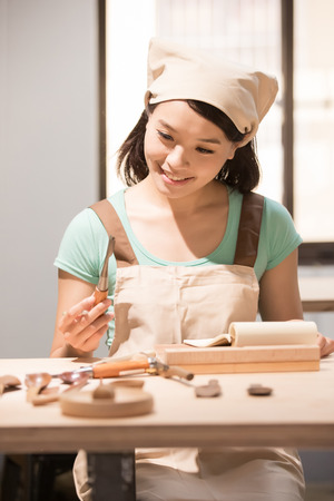 expertise: woman woodworking look and smile happily ,asian Stock Photo
