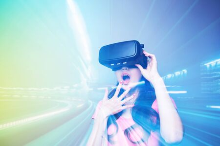Double exposure of afraid woman watching VR-headset glasses for virtual reality concept Stock Photo
