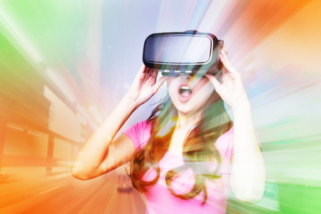 virtual reality simulator: Double exposure of happy woman playing VR-headset glasses for virtual reality concept