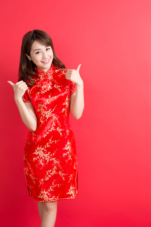 beauty woman wear cheongsam and thumb up with chinese new year Archivio Fotografico