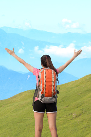 woman climbing moutain and feel free ,asian