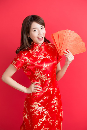 beauty woman wear cheongsam and take Red envelopes  chinese new year Stock Photo