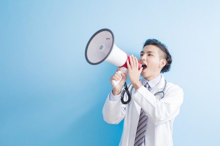 proclaim: male doctor take microphone to you,asian Stock Photo