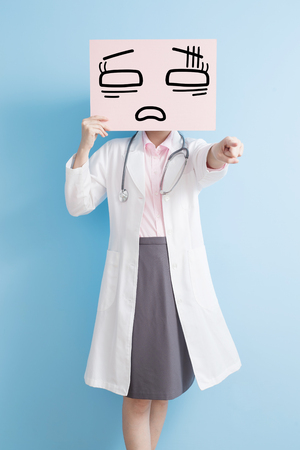 woamn doctor take tired billboard and show something to you,asian Stock Photo