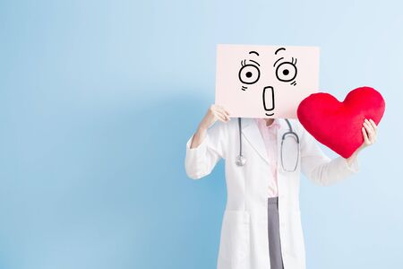hysteria: woman doctor take surprise billboard and heart isolated on blue backgorund, asian