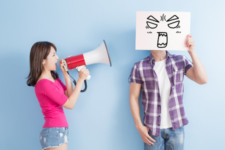 problem: woman take the microphone shout to man take angrily billboard isolated on blue background