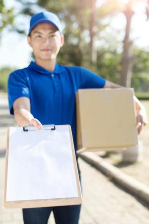 warehouseman: deliveryman take cardboard and smile to you,asian