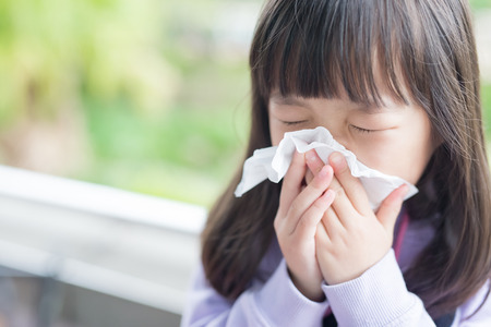 fever: little girl get cold and blow her nose,  asian