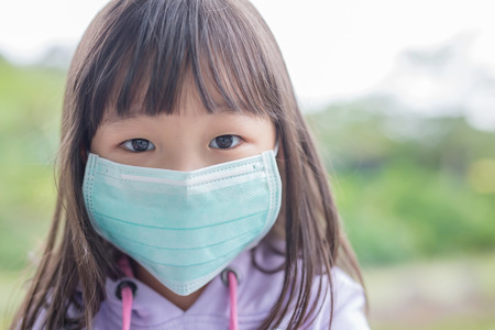 cute little girl get cold wear mask,  asian 版權商用圖片