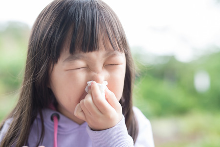 little girl get cold and blow her nose,  asian Stock Photo - 71742409