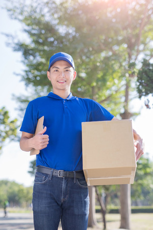 storage box: deliveryman stand and thumb up, asian