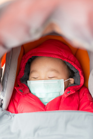 resting: cute baby get cold wear mask,  asian