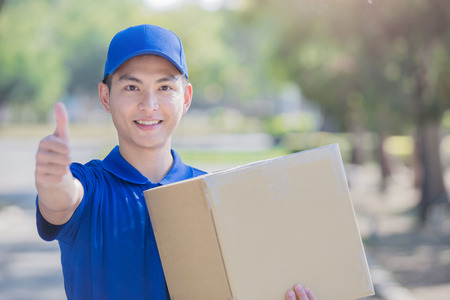 deliveryman stand and thumb up, asian