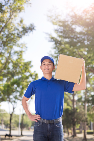 deliveryman stand and smile to you, asian