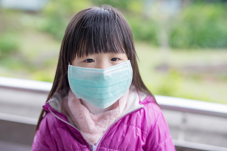 cute little girl get cold wear mask,  asian Stock Photo