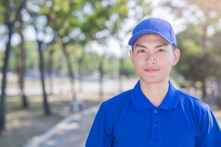 post man: deliveryman stand and smile to you, asian