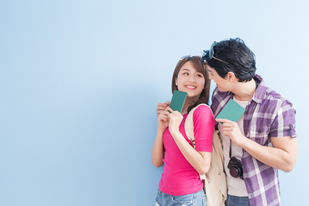 young couple go to travel and take passport Фото со стока